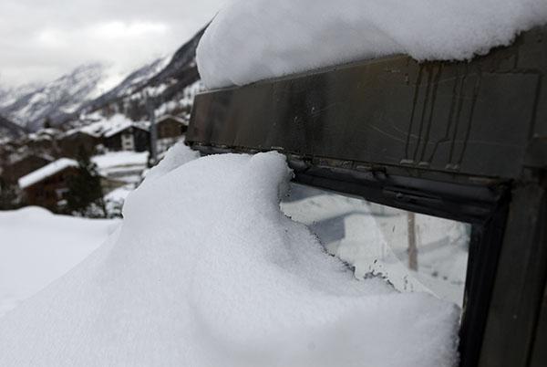 Car snowed under